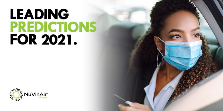 Leading predictions for 2021. Woman wears a mask in backseat of vehicle.